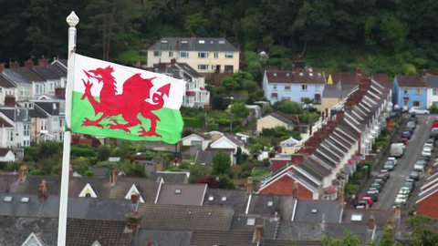 Welsh flag blowing in the wind above the Mumbles area in Swansea