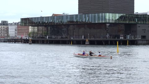 Copenhagen, Denmark - 21 September 2015: A kayak makes it way past The Royal Danish Playhouse at the harbor front