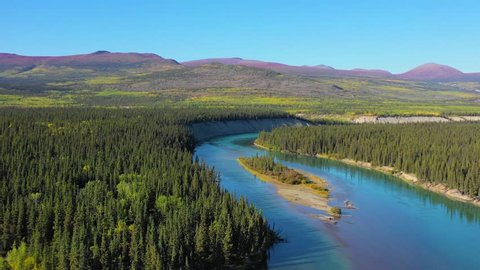 Flight over a small island at Mendenhall Landing on the way to Kusawa Lake, 5km from the Alaska Highway, on a sunny day in the Yukon in Canada.