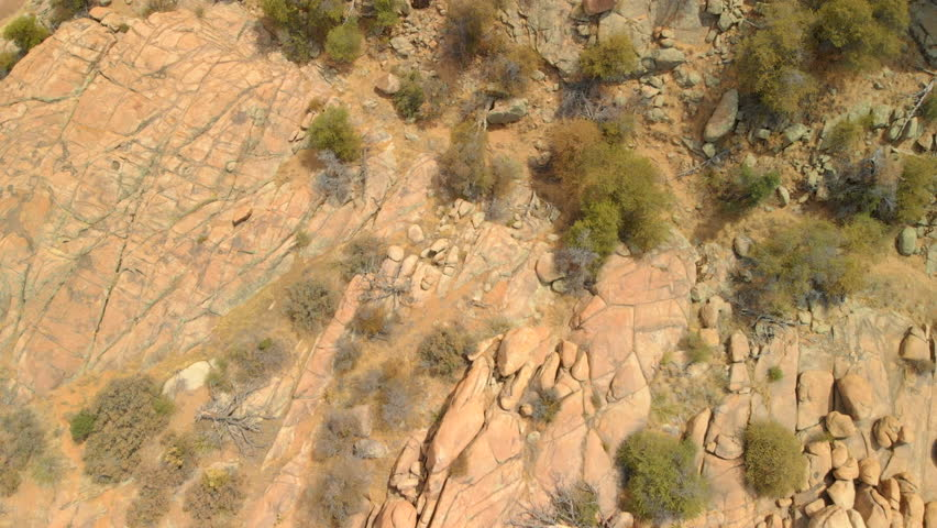 Aerial top down close up view of granite dell rock formation and vegetation surrounding Watson Lake Arizona. | Shutterstock HD Video #1016425306