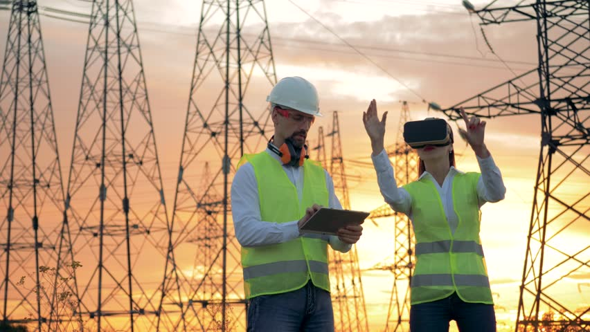 Electricians work with 3D VR glasses.
