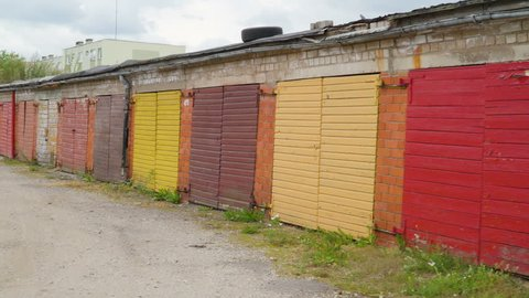 Closer look of the colorful gates of the wooden bunk houses with the brick walls on it