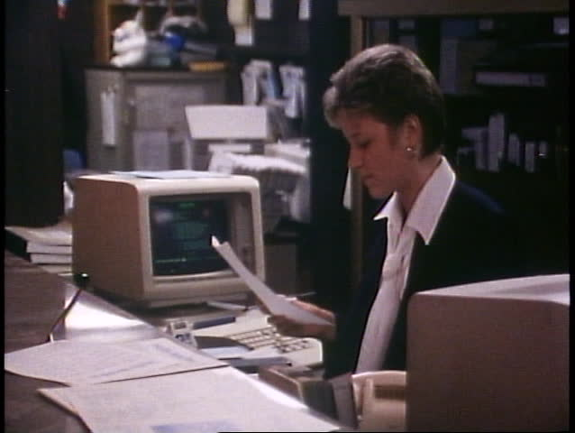 ALASKA CRUISE, 1989, Woman at computer at a hotel desk on ship | Shutterstock HD Video #1016470786