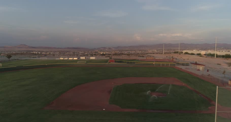Aerial Drone Shot Flying Past Empty Baseball Diamonds With Sprinklers On Field In Las Vegas Nevada | Shutterstock HD Video #1016501716