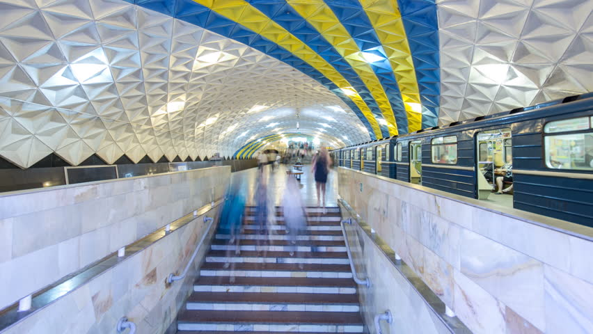 An underground train departing from Sportivna metro station on Kholodnogorska Line of Kharkiv metro timelapse hyperlapse, with a passengers on a platform, in Kharkov, Ukraine