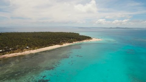 aerial footage tropical island with beach and palm trees lagoon with turquoise water Sea tropical landscape Daco island, Philippines, Siargao. Travel concept Aerial video