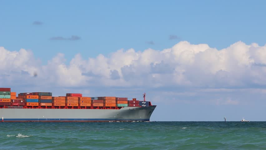 USA Fort Lauderdale Florida October 2014 Large container ship departing to the ocean from Fort Lauderdale  #1016563306