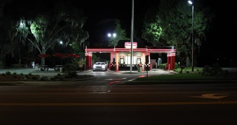 SEPTEMBER 19, 2018, INVERNESS, FL: Wide shot of dual drive-thru fast food restaurant, Checkers. It's bright neon exterior and hip retro look take customers back in time to the 1950s.