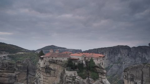 Overcast sky over holy Varlaam monastery on cliff in Meteora, Thessaly Greece. Greek destinations. Time lapse