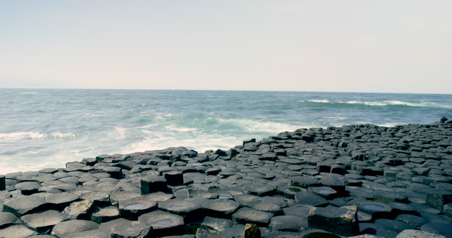 A time-lapse of waves breaking along the hexagon shaped shoreline of the Giant's Causeway in Ireland.