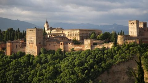 Alhambra panoramic scenic view with blue cloudy sky at sunset in Granada. Andalucia, Spain.