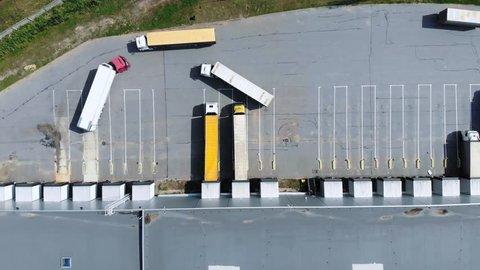Aerial view of trucks unloading in logostics center