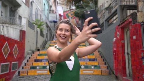 Happy beauty young brazilian woman taking a selfie photo in Rio de Janeiro, Brazil