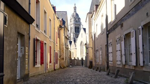 Paved street of the old town of Le Mans. Le Mans is a city in western france. It's a located in the Pays de la Loire region.