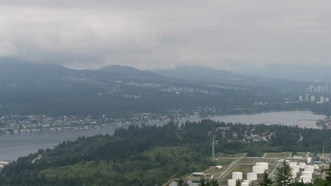 Timelapse of an Industrial Site in Port Moody during a cloudy summer day. Taken from the top of Burnaby Mountain, Vancouver, BC, Canada.