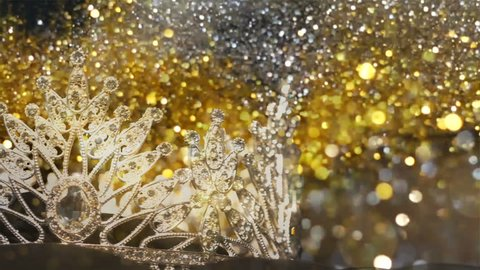 Diamond Silver Crown for Miss Pageant Beauty Contest, Crystal Tiara jewelry decorated gems stone and explode glitter bokeh sparkling Slow abstract background, Slider moving left to right copy space