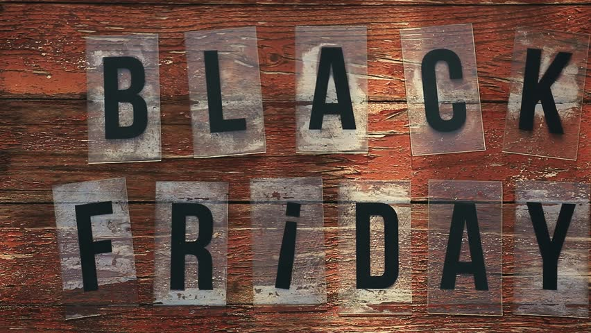 Black Friday text wooden table  | Shutterstock HD Video #1016747566