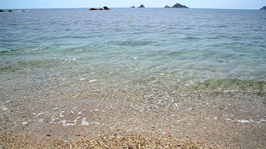 the splendid sea of Sardinia  ( Sardegna )- waves on the beach and the desire to swim - shore and by the sea