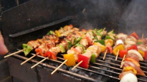 close up chicken kebabs kabobs in smoking BBQ