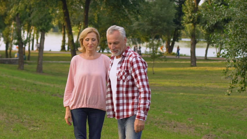 Old couple walking and kissing in park, bright future, timeless love, slow-mo | Shutterstock HD Video #1016803936