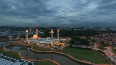 Aerial Time lapse of sunset and clouds at Masjid Tengku Ampuan Jemaah Mosque in Selangor, Malaysia from day to night at dusk.