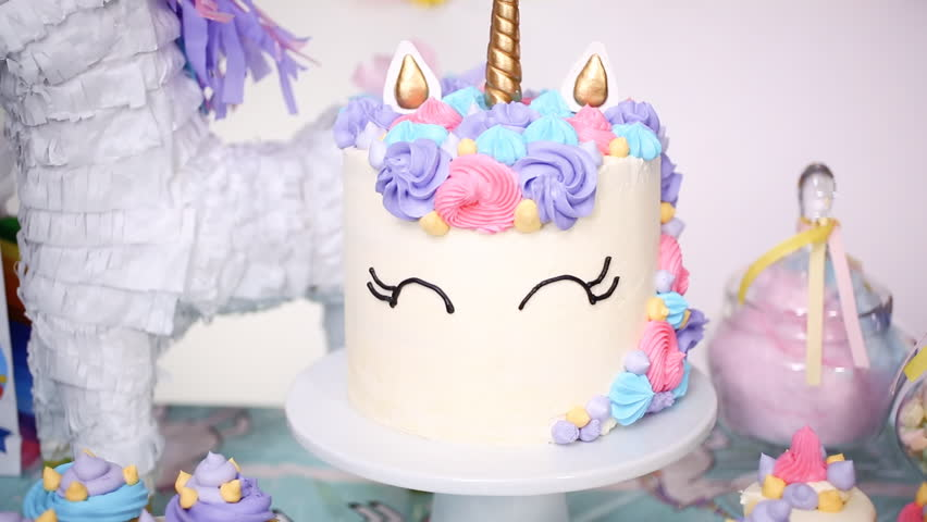 Unicorn Cake With Buttercream On The Party Table At Little Girls Birthday