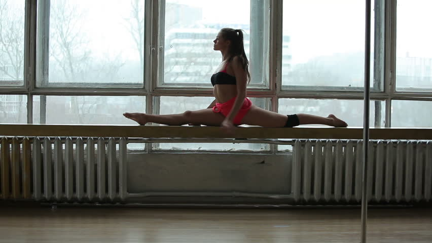 Beautiful young woman doing pole dance, female dancer, fitness and sport.  | Shutterstock HD Video #10169096
