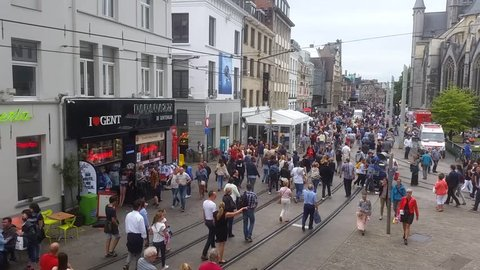 Gent, Belgium - 15 July, 2017: People walking in the streets during the Gentse Feesten (Gent Festival). The event includes music and theatre, like street acts such as mimes and buskers.
