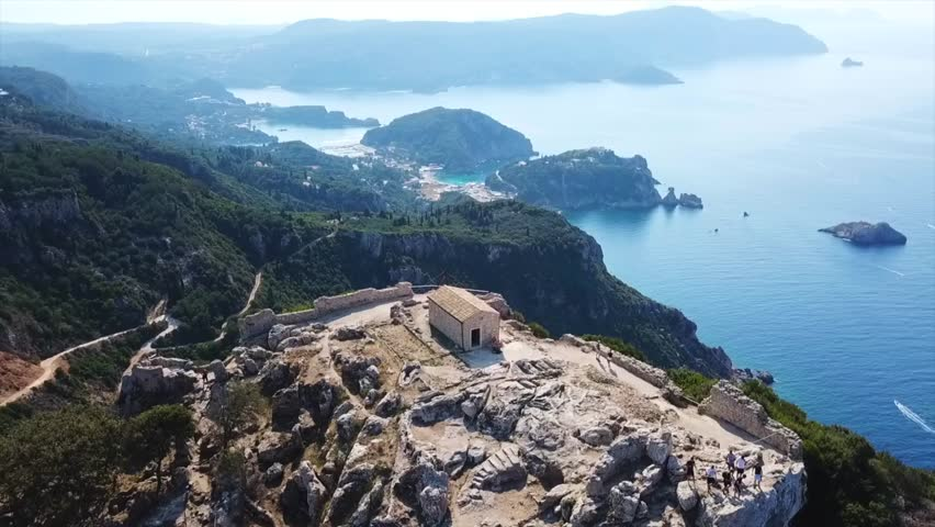 Aerial drone video of iconic medieval fortified castle of Aggelokastro with amazing views, which is also referred to as Angel Castle located in close to Paleokastritsa, Corfu island, Ionian, Greece
