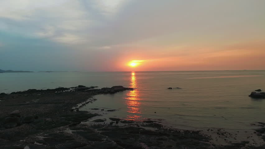Sunset in the sea by drone   Shutterstock HD Video #1017041986