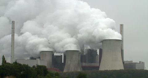 RWE power plant working on lignite producing electricity and huge clouds of steam in Neurath, Germany, 4K