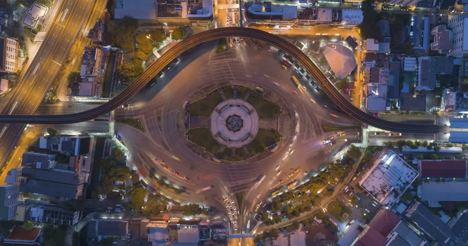 Aerial top view traffic road roundabout in city at night, Time lapse top road in bangkok. | Shutterstock HD Video #1017081856