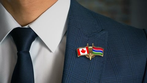 Businessman Walking Towards Camera With Friend Country Flags Pin Canada - Gambia