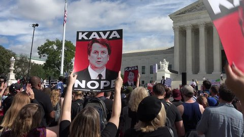 WASHINGTON, DC - SEPT 28, 2018: Rally at Supreme Court against Bret Kavanaugh nomination for associate justice. Cheers, Kava Nope signs, supreme court bg.