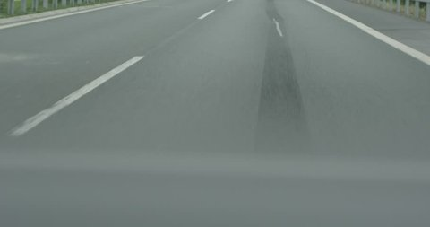 4k camera moving above asphalt road close up low angle view fast speed car overtaking macro shot. Aerial flight on empty two-lane highway detail. Traffic auto transportation logistics concept