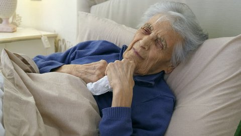 Elderly caucasian woman with heart attack, chest pain. (senior adult 80+)
