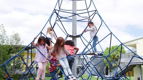 Elementary school kids climbing in the school playground