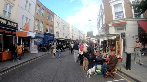 LONDON- SEPTEMBER, 2018: Hyper lapse of Portobello Road market, a landmark street in Notting Hill are of West London famous for its market and fashionable shops
