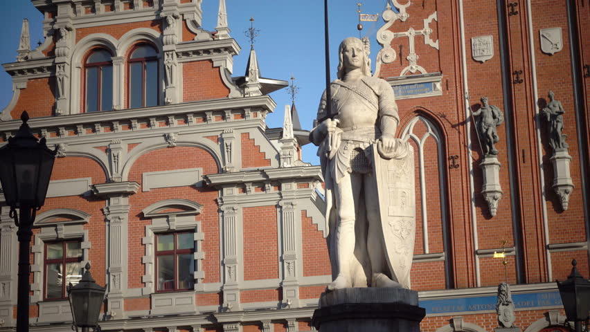 view of a monument to Roland at Town Hall Square against the background House of the Blackheads of Riga Latvia