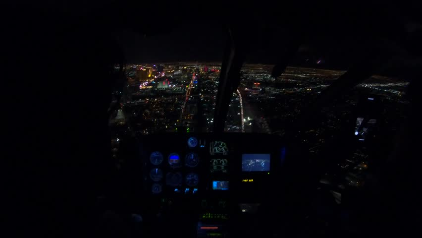 Helicopter interior on Las Vegas buildings and skyscrapers of downtown with illuminated casino hotels at night. Scenic flight above Vegas skyline by night in the Nevada United States of America. | Shutterstock HD Video #1017194506