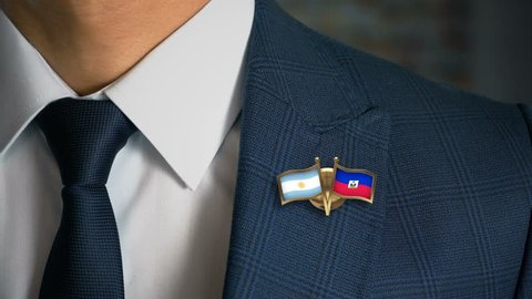 Businessman Walking Towards Camera With Friend Country Flags Pin Argentina - Haiti