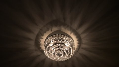 Luxurious Chandelier Throwing Shadows At The Ceiling
