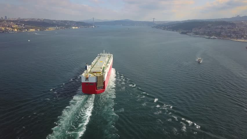 Istanbul Bosphorus Sea. Aerial following the Ro-Ro ship sails out to sea. She is heading towards the suspended bridge. Pure car and truck carrier (PCTC) underway in Turkish Straits