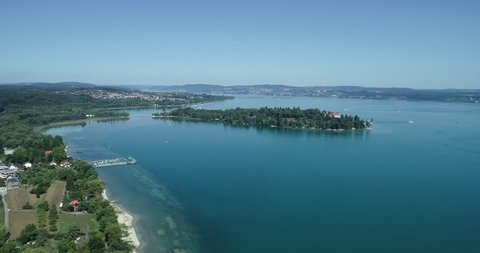 Aerial, Camera zooms in toward Mainau Island (German: Insel Mainau), over Lake Constance (German: Bodensee).