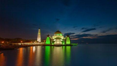 Dramatic Time lapse of sunrise and scattered clouds at a floating Masjid Selat Melaka mosque in Malacca, Malaysia. Night to day. Prores 4K