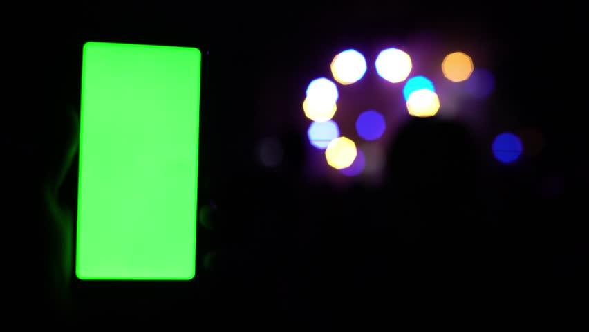 close-up view of modern smartphone on concert festival rock party rave concert lights bokeh blurred background 4k