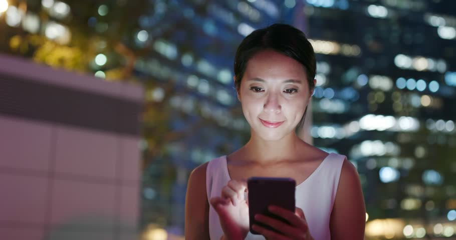 Woman watch on cellphone in city at night | Shutterstock HD Video #1017251146
