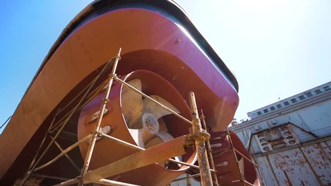 Ship Under Repair in Floating Dock . Overhaul and Modernization of Ships . View of the Repaired Propeller