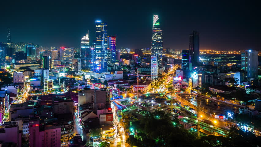 Time lapse view of Ho Chi Minh City aka Saigon, Vietnam, showing landmark buildings and traffic in the financial district at night.  #1017266026
