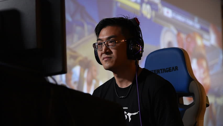 SACRAMENTO - APRIL 1: eSports athlete Bruce Yu-lin Gamerbee Hsiang playing Street Fighter V match at video game tournament NCR NorCal Regionals 2018.